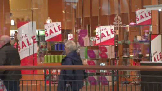 Malls packed as people head out for post-holiday shopping, gift returns
