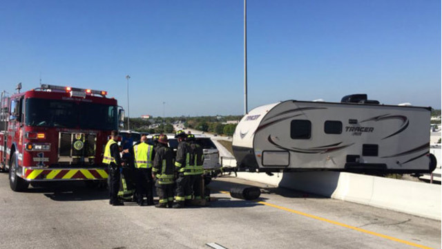 Crew Removes Dangling Camper From Interstate Overpass