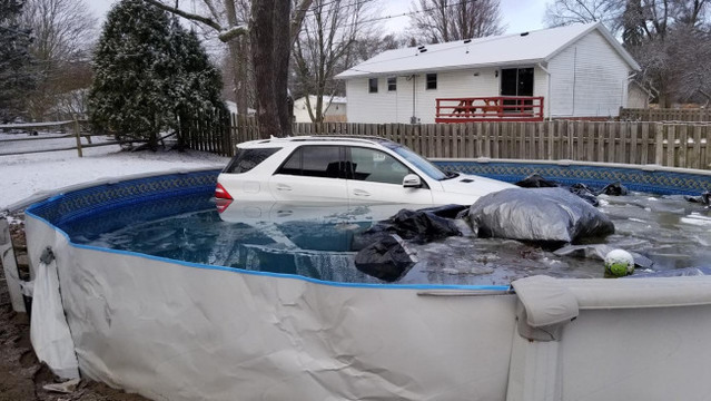 Car stranded in above-ground pool after Ohio crash