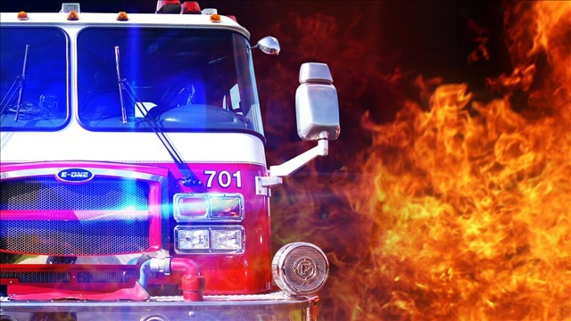 Fully involved house fire shuts down road in Kanawha County